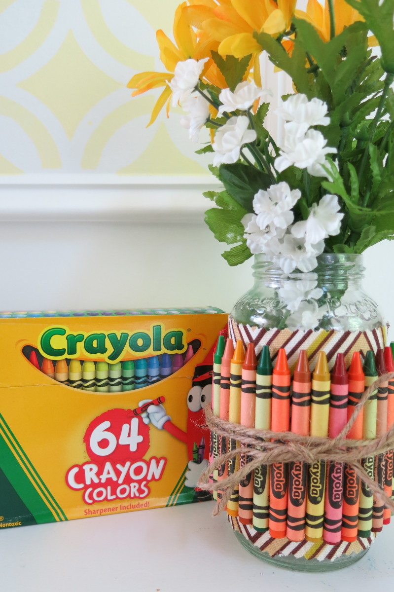 You can add fabric or decorative paper to your crayon covered jar