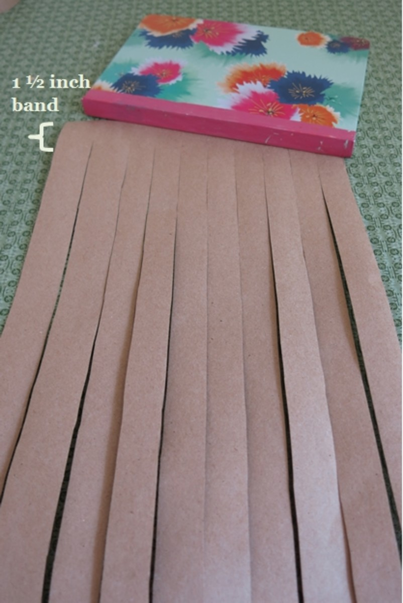 Cutting your paper to make a woven paper journal or sketchbook cover.