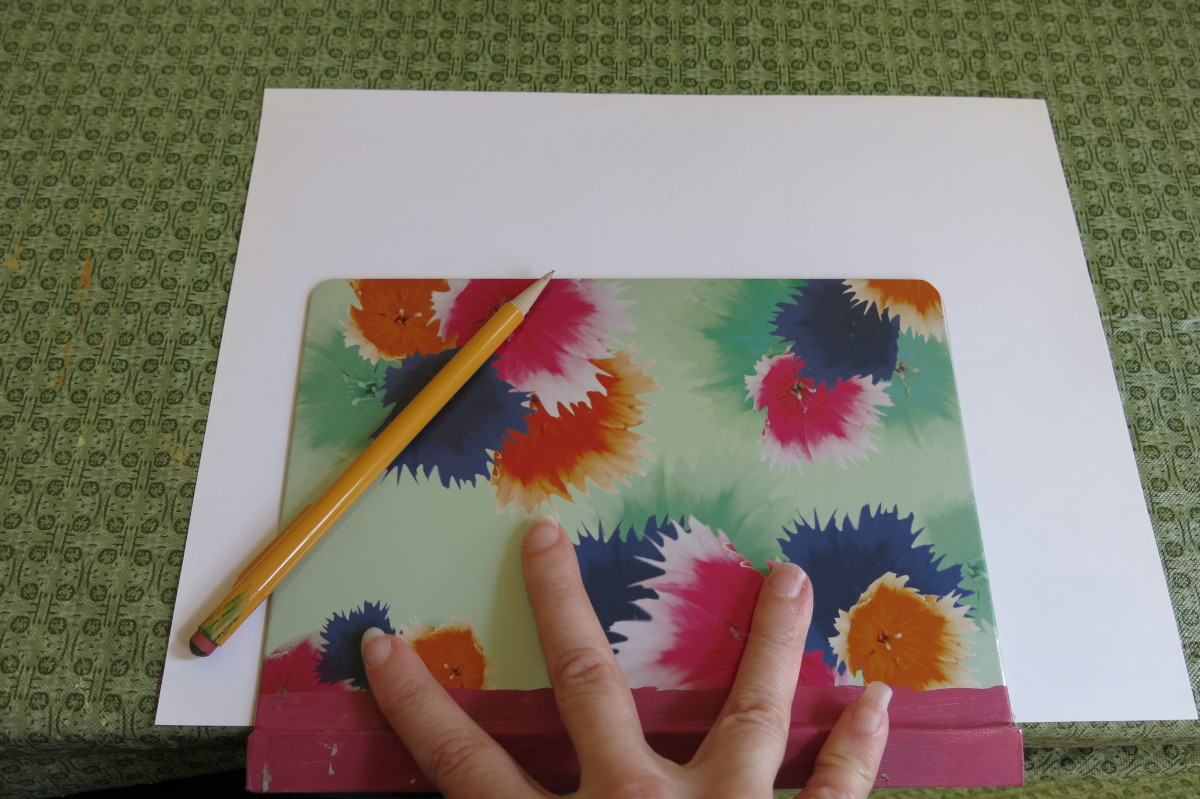 Tracing the front cover of your book to create a woven paper book cover.