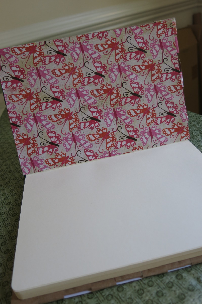 Trim some decorative paper to hide your paper ends on your inside cover.
