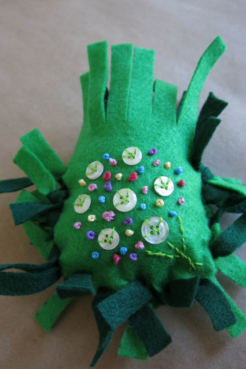 Once three sides of your fringe is tied, you can stuff your pincushion.