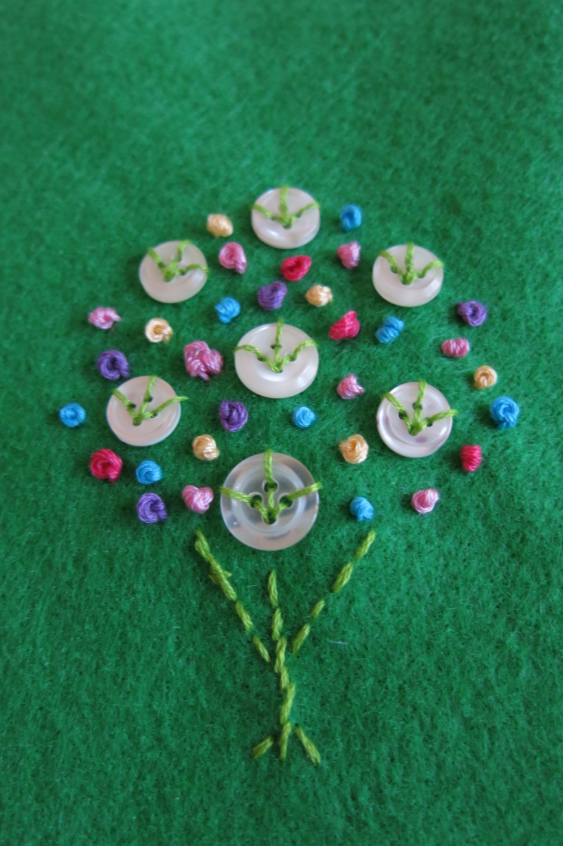Sew some simple  french knots to create an embroidered floral bouquet.