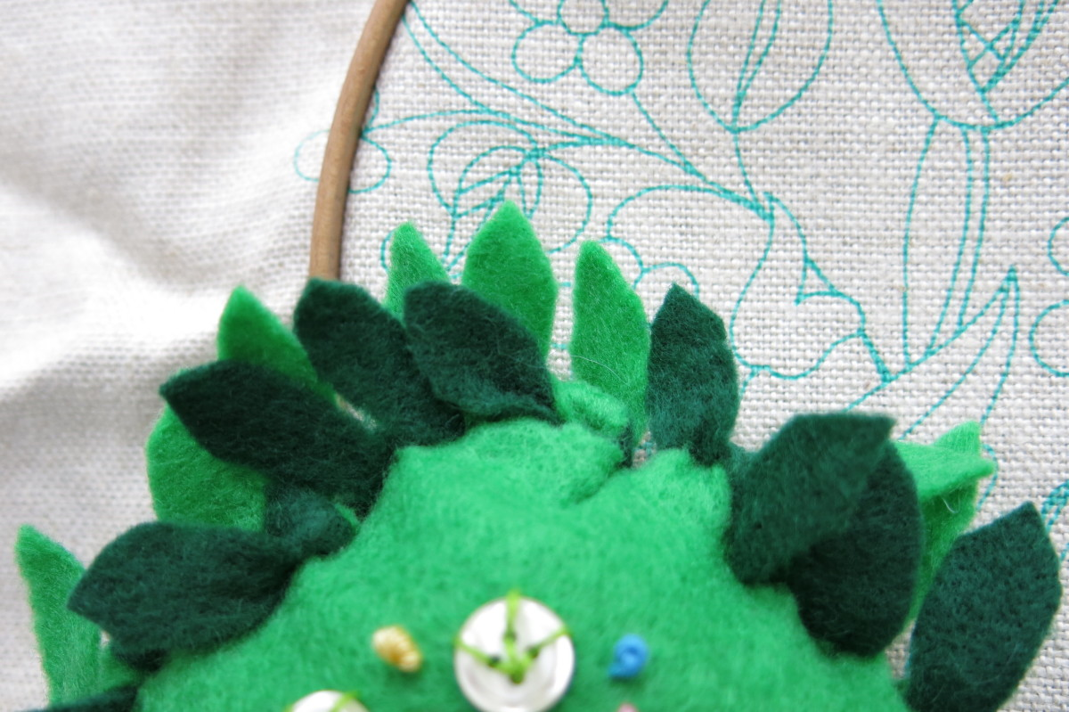 To finish your no-sew pincushion, cut each piece of fringe to look like a flower petal.