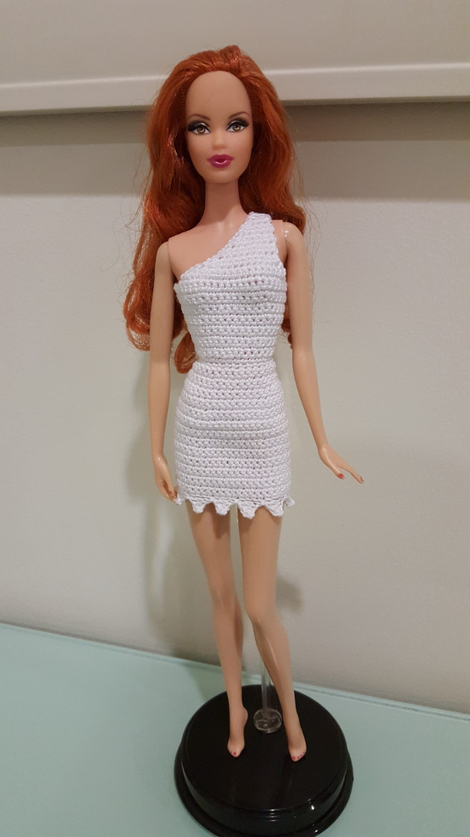 Here's Barbie posing in the completed Wilma Flintstone–style bodycon dress.