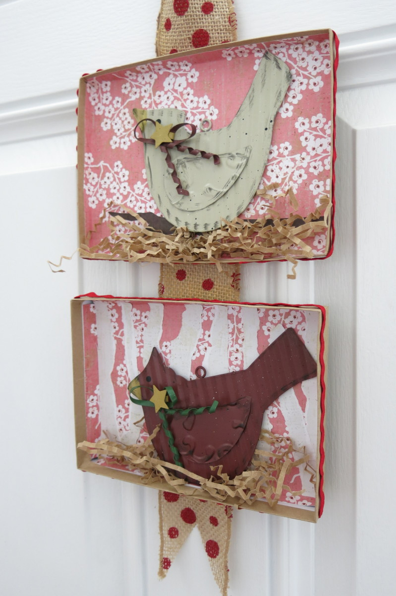 Mount flat Christmas decorations in frames or on canvases to create wall art.