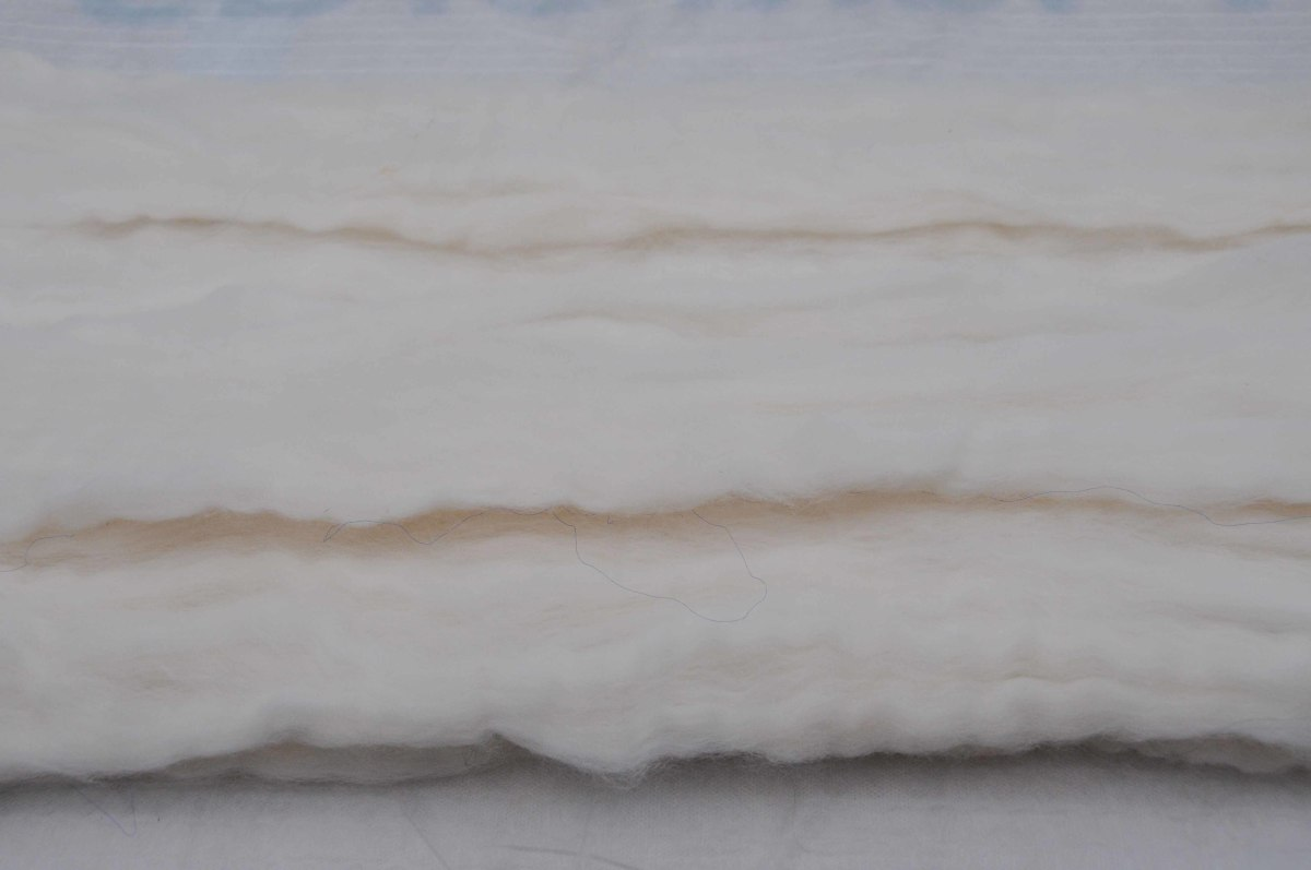 Wool roving pulled out to make a single sheet of white wool