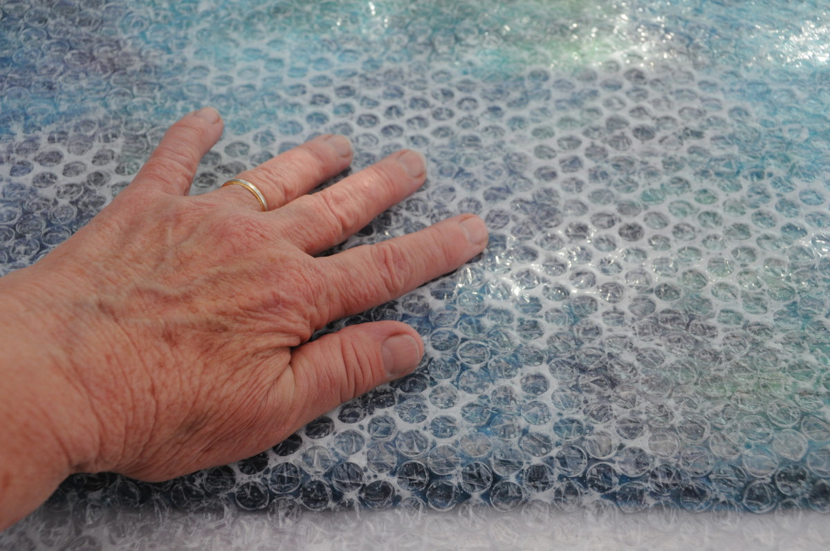 Cover with bubble wrap and rub firmly for a while.