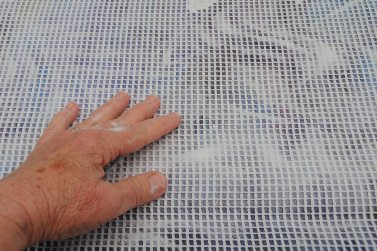Rub until smooth and then remove the netting and fold in the edges.