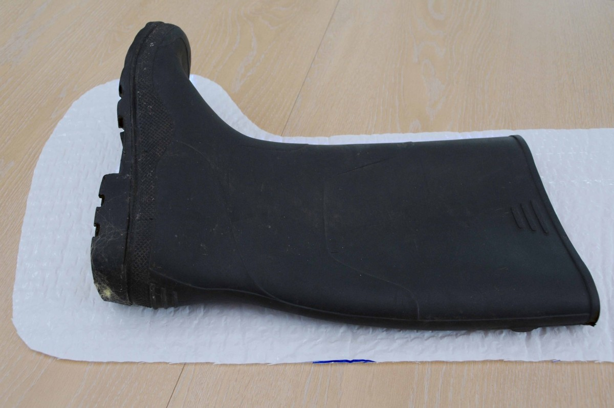 Checking the height of the boot on the template.    For longer boots retain the complete length of the boots for your template.
