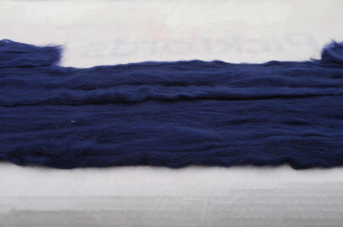 Pull out the fibers from lengths of roving and put down onto the template, repeat on the other side.