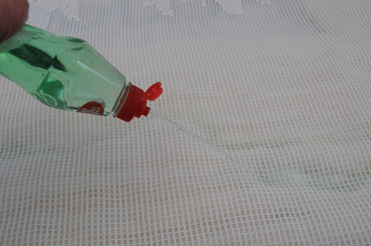 Cover with curtain net and wet with hot soapy water.