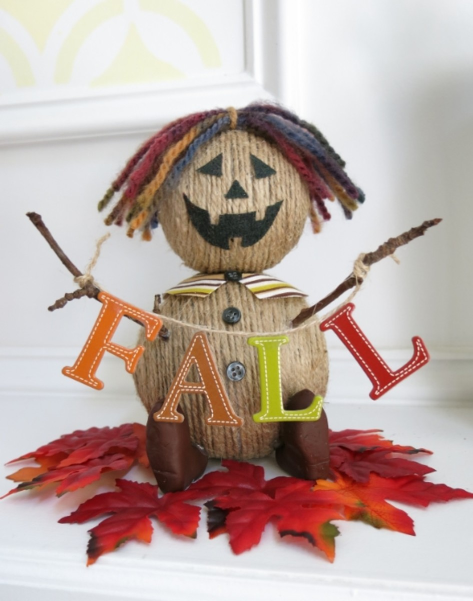 A banner is optional but a fun accent to your fall scarecrow decoration.