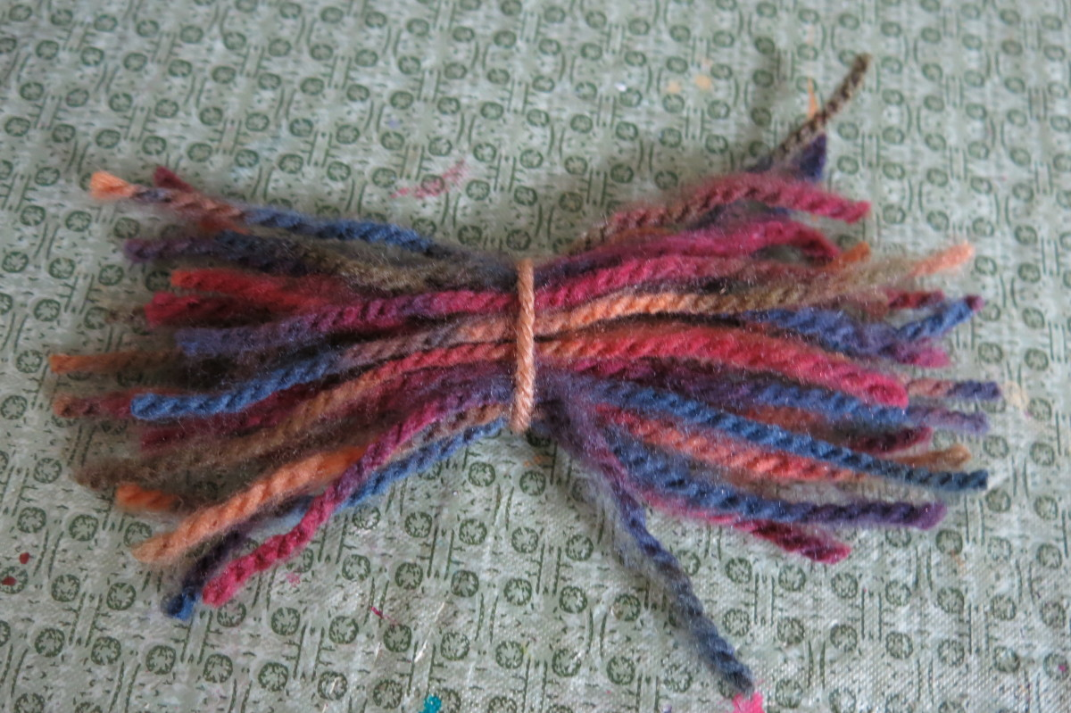 Use yarn to make some fun hair for your twine scarecrow.