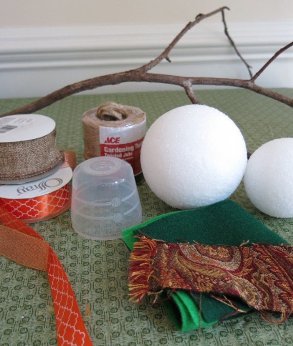 Materials for making a fall twine scarecrow decoration.