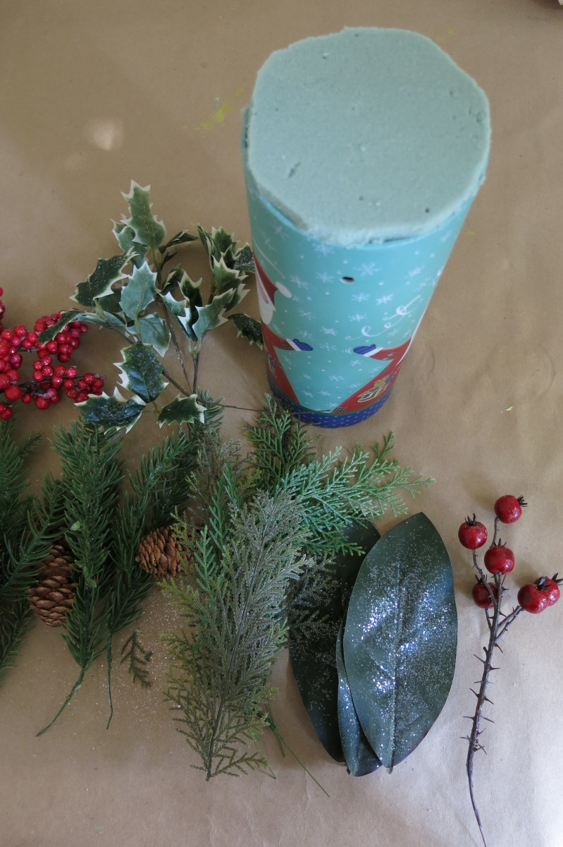 Preparing your materials for making a Christmas floral arrangement.