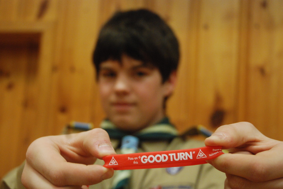 A Scout displays a bracelet to promote Good Turn Week, a time when the organization gives back to the community.
