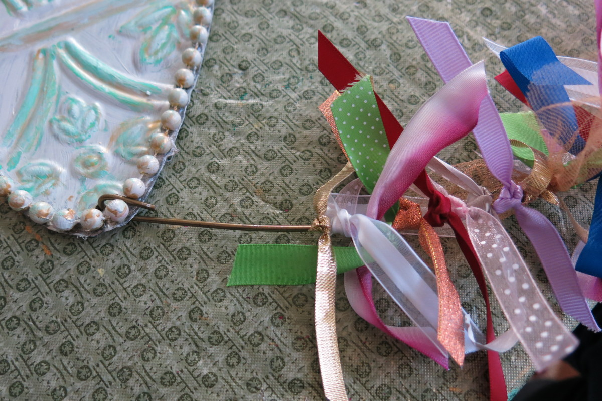 Adding ribbon to your dragonfly decoration or wreath