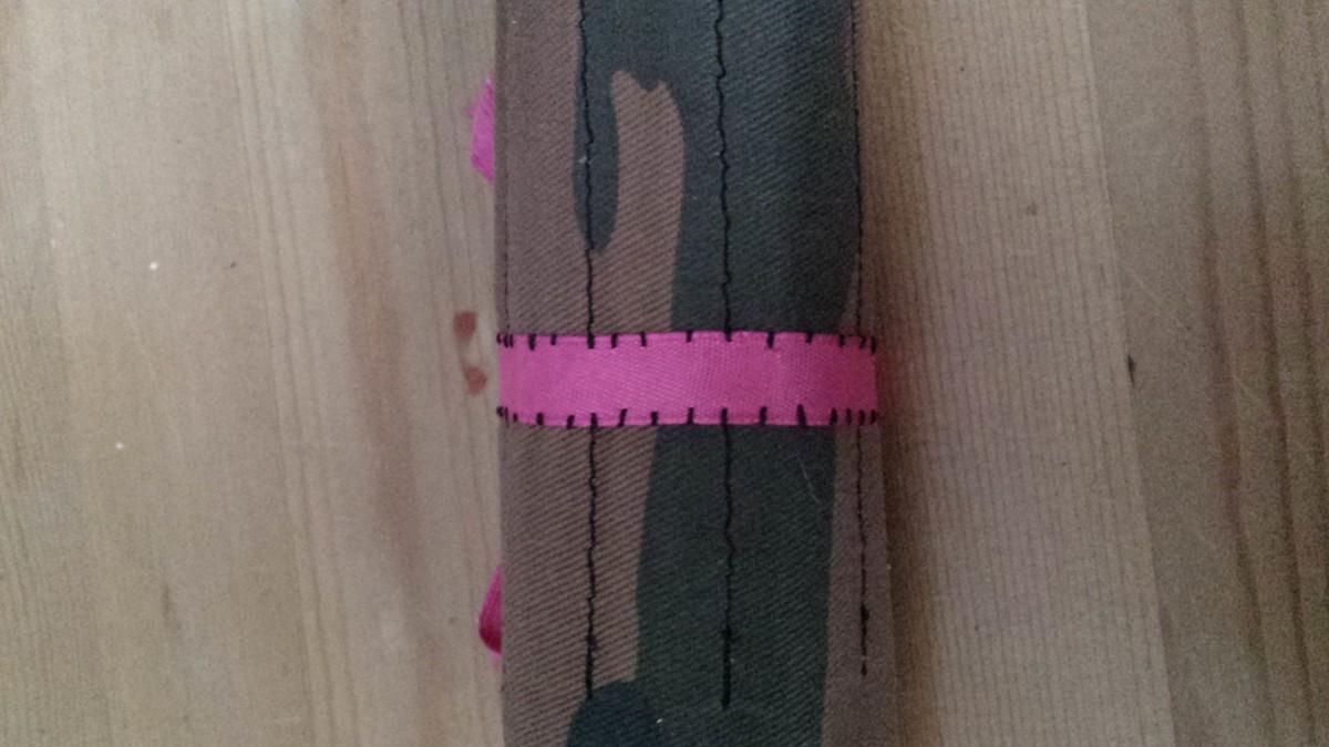 hand stitching the ribbon on