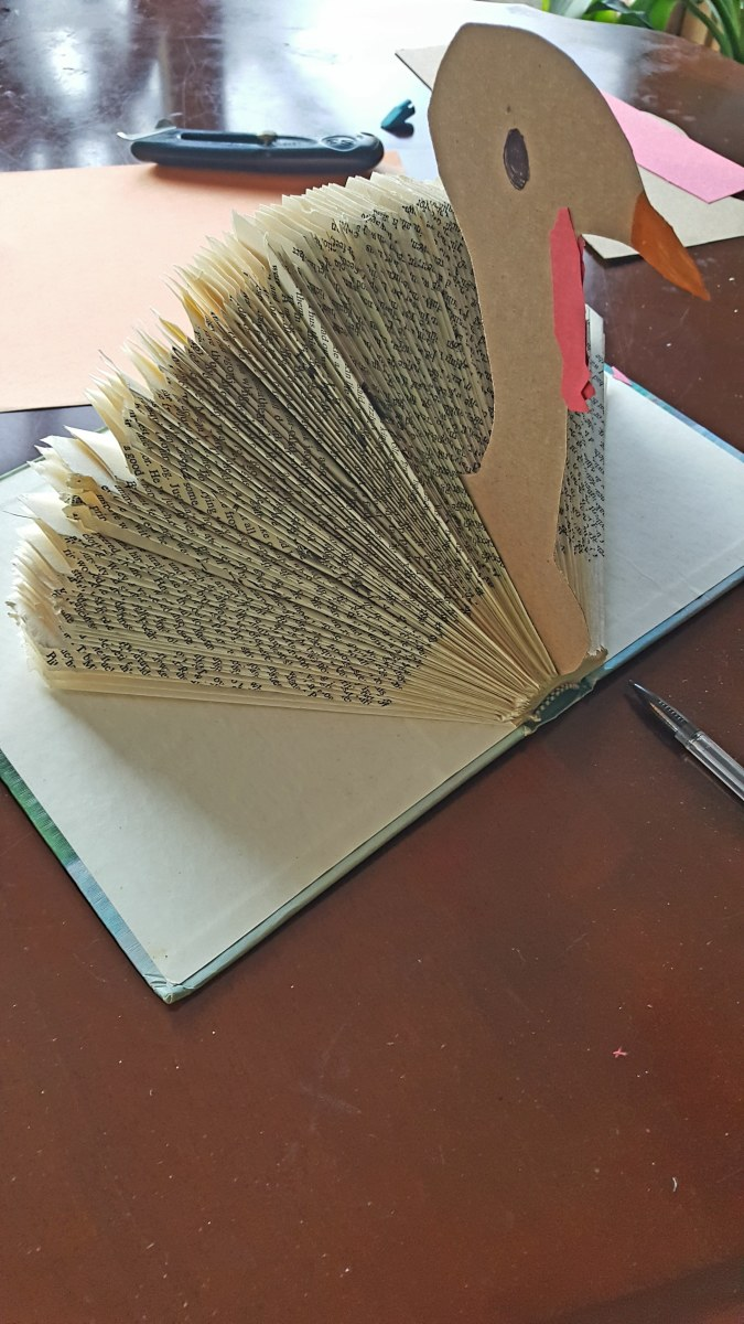 Attach your turkey head in between two pages, in the middle of your book.