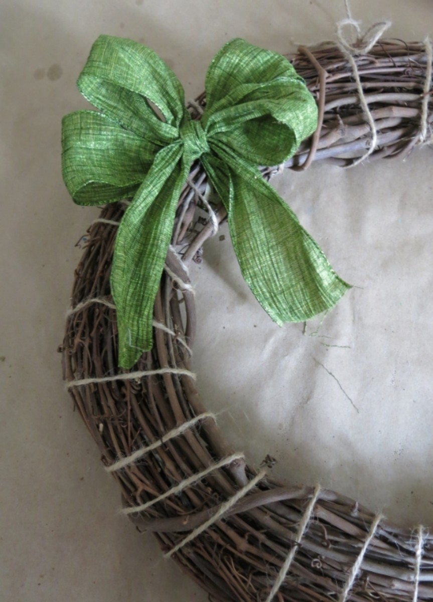 Adding a bow to your wreath