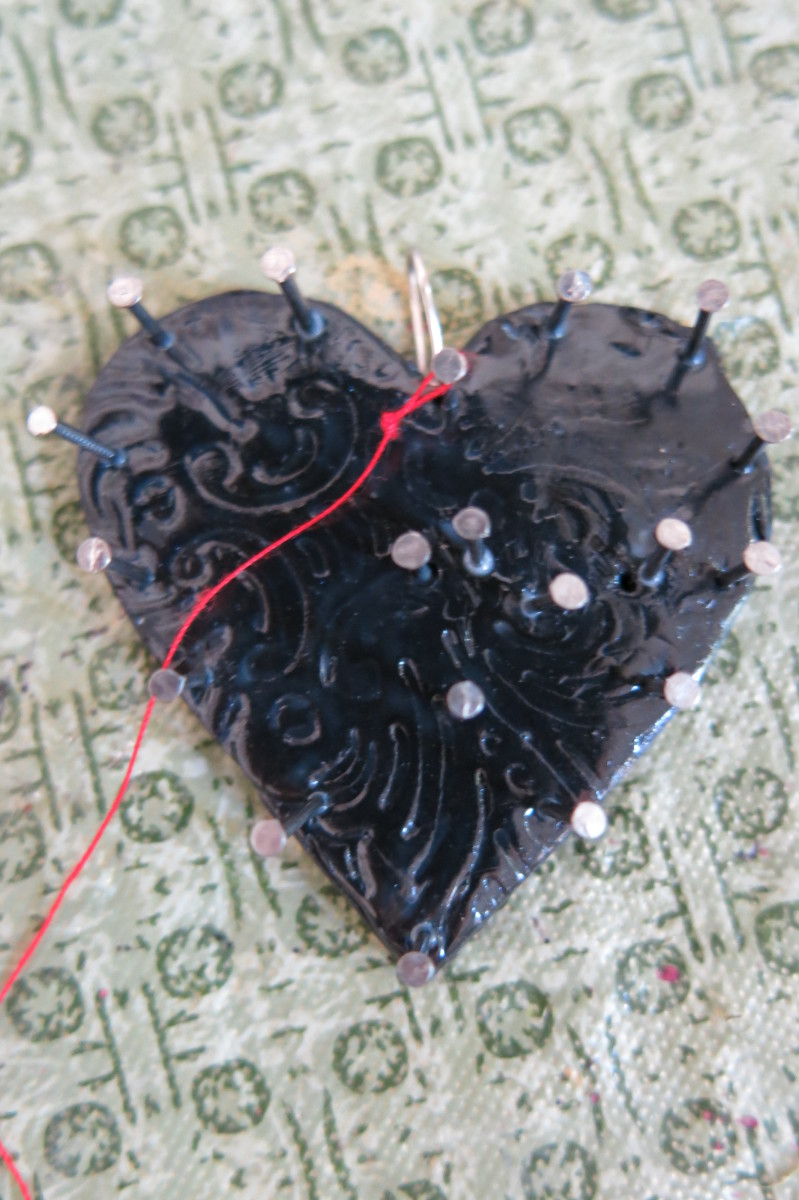 Begin wrapping your thread to create your string art pendant or brooch
