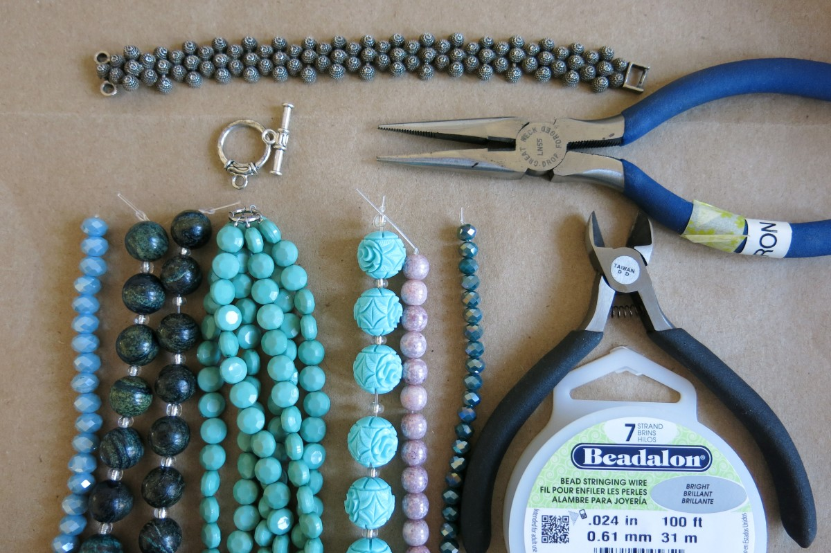 Materials for Making a Necklace From an Old Bracelet or Shorter Necklace