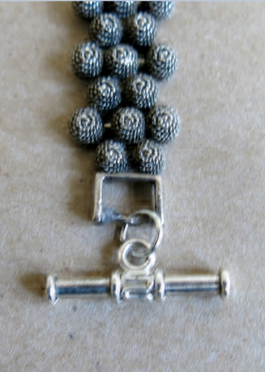 Use a jump ring to attach the clasp to the loop or ring of the bracelet.