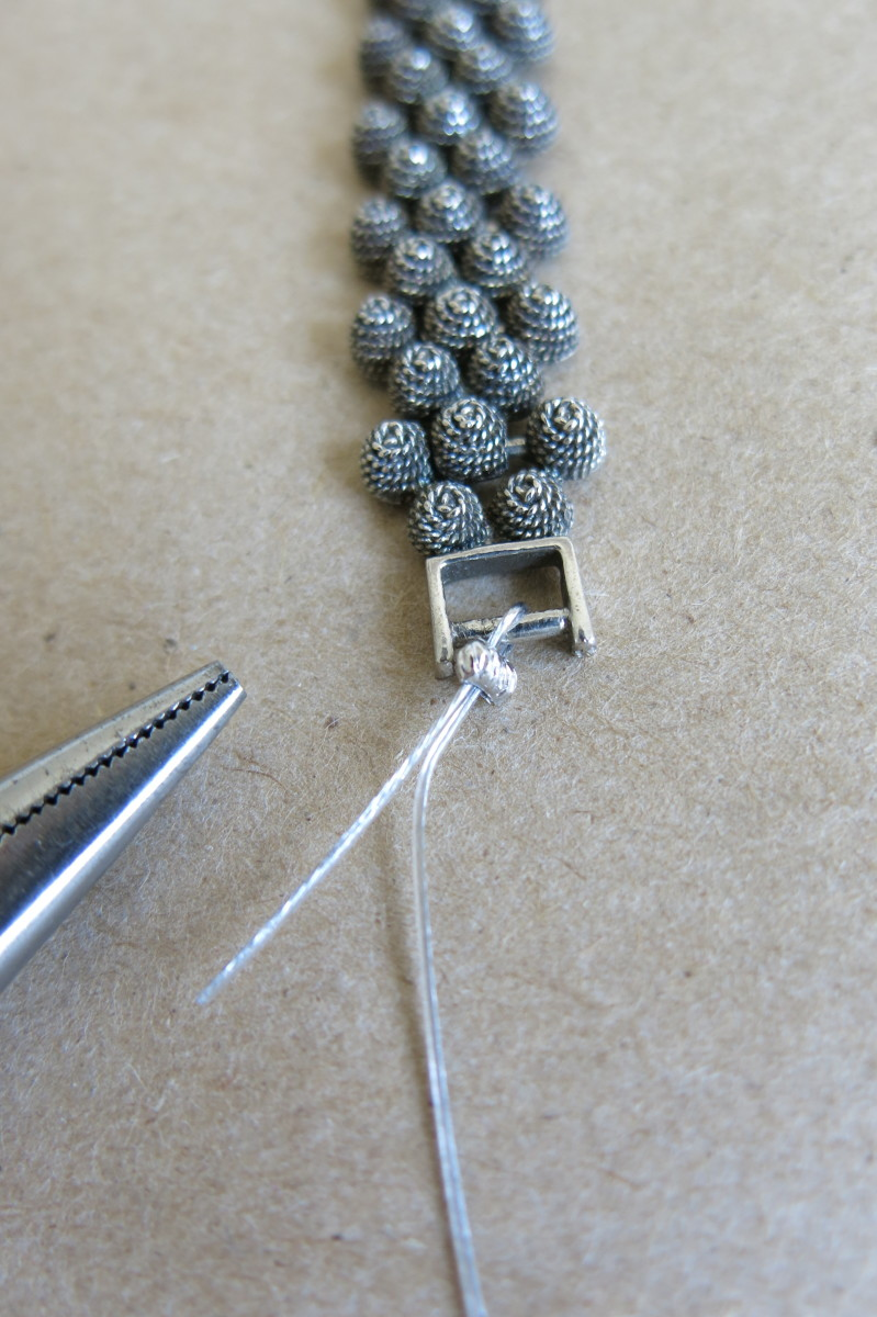 Attach beading wire and crimp beads to your bracelet.