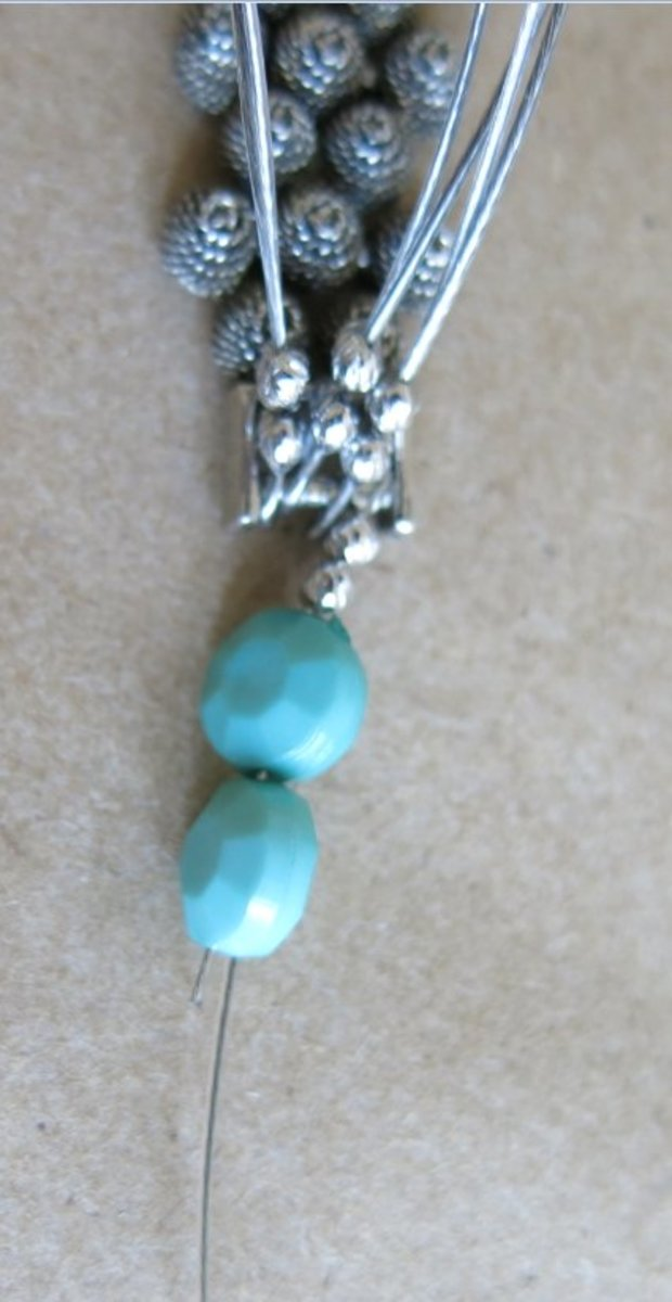 Begin adding beads to your necklace.