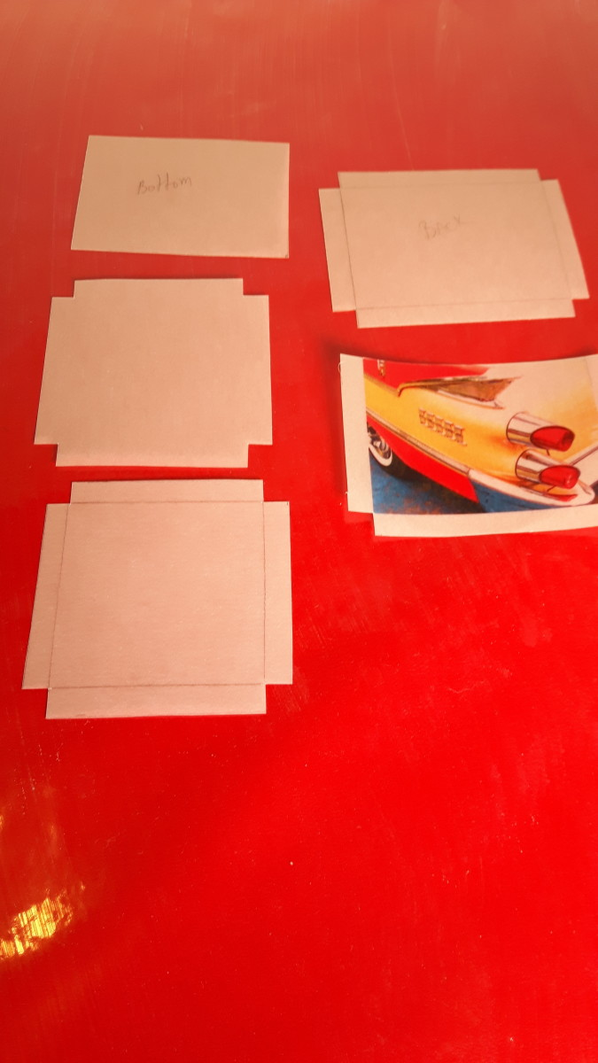 The sides and bottom are cut out ready to fold the gluing tabs.