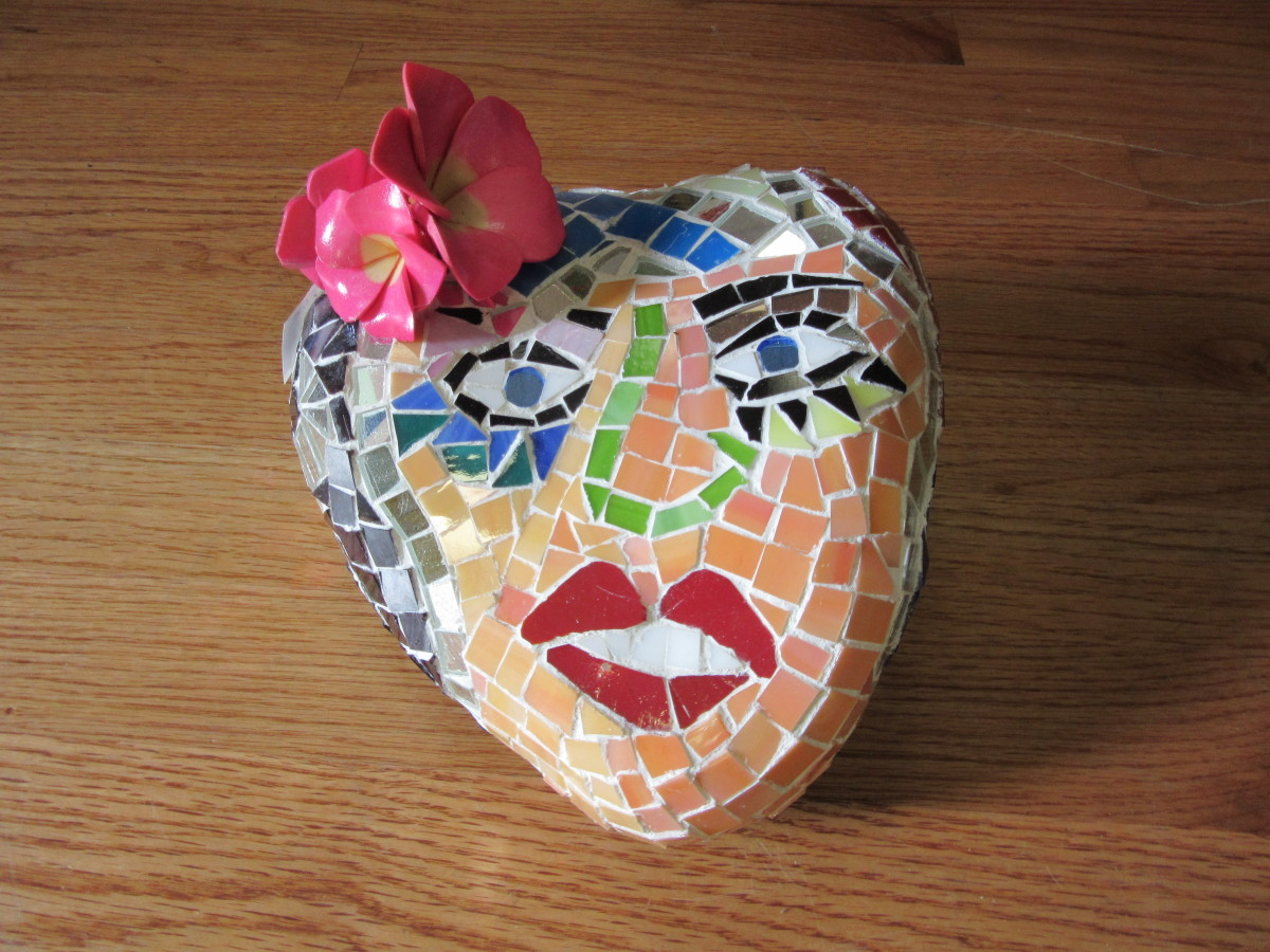 Artwork by Dawn Kovera, mosaic technique on large rock