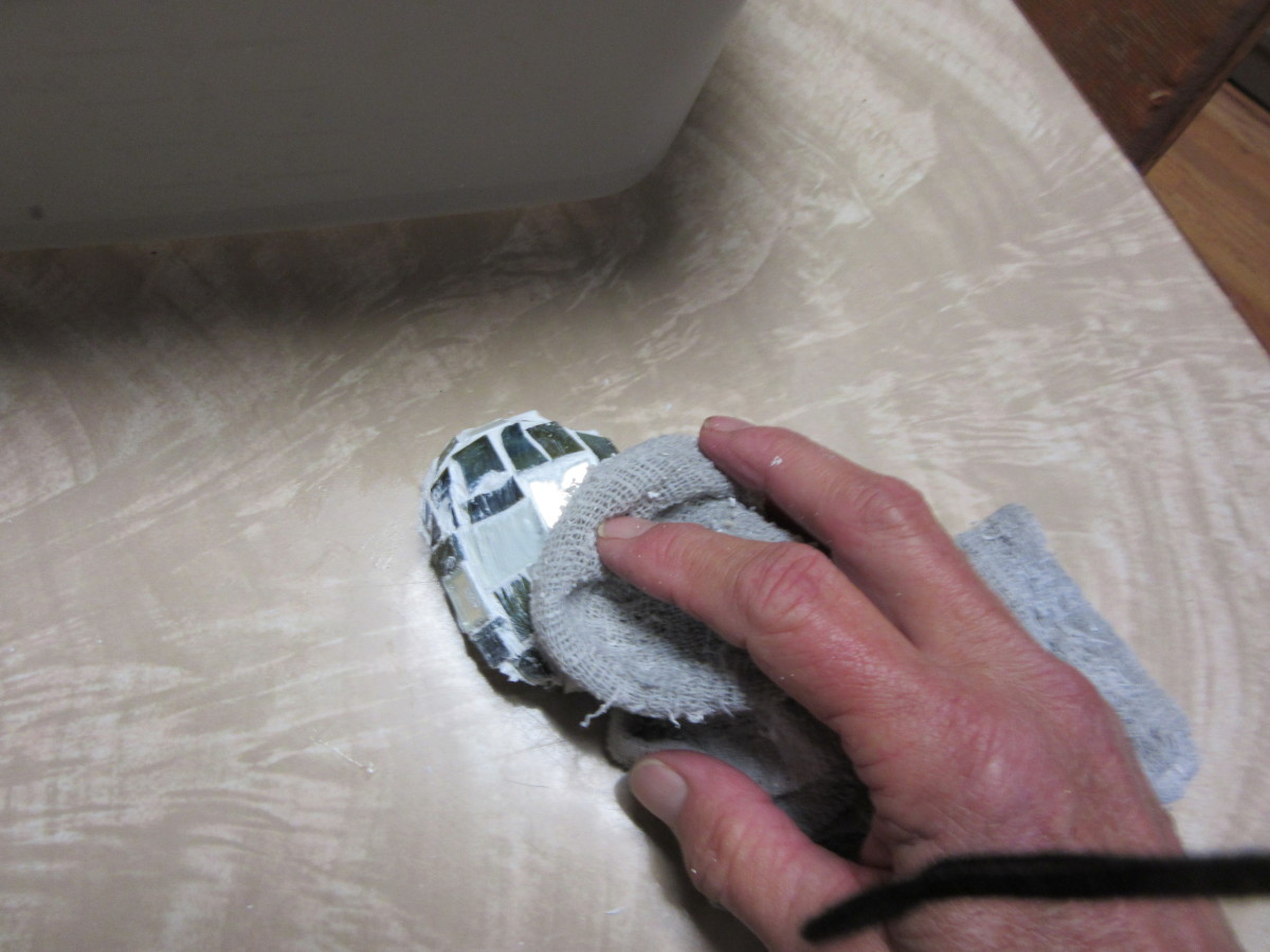 Wipe the residual grout off of the glass