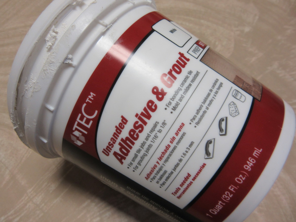 We like to use an adhesive and grout mixture that can be purchased ready to use.