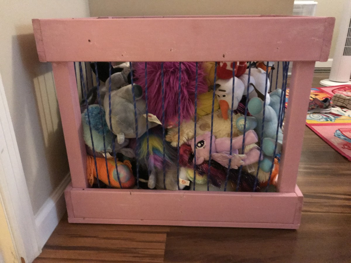 The completed stuffed animal cage holding stuffed animals.
