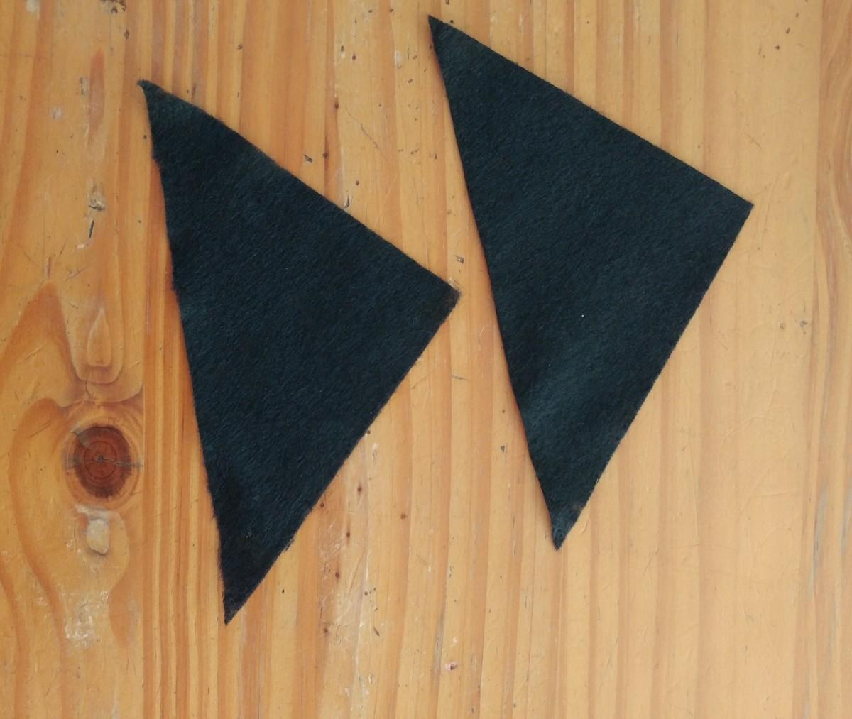 Cut black felt in shape of triangles.