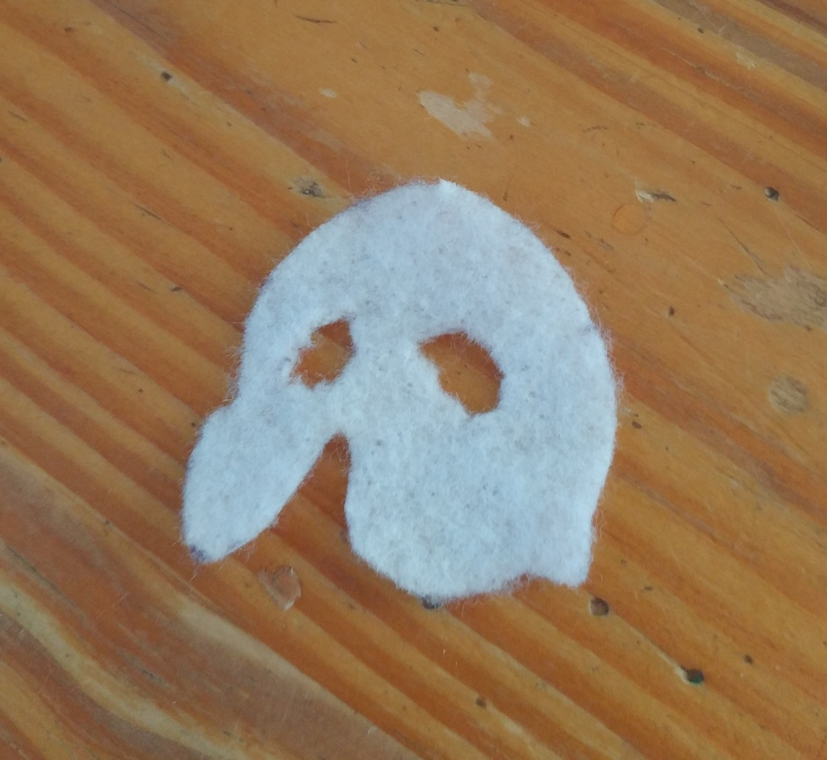 Cut out shape of the Phantom mask, out of white felt.