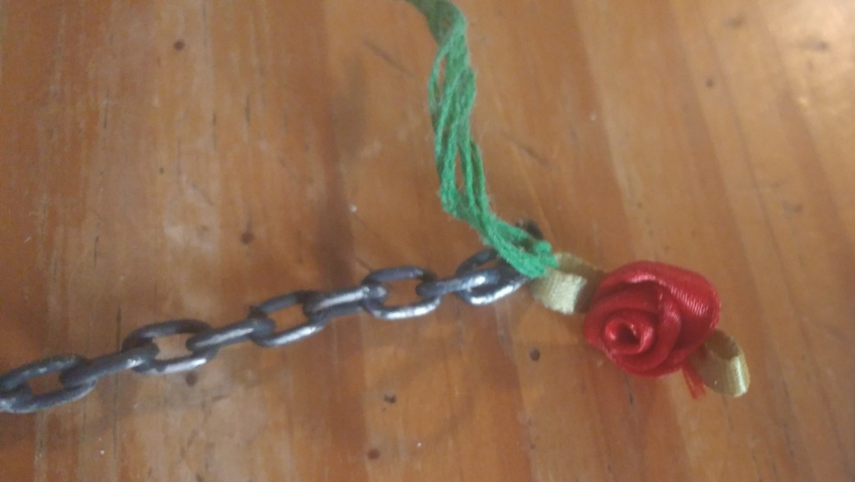 A tiny fabric rose is perfect, to tie next to the mask.