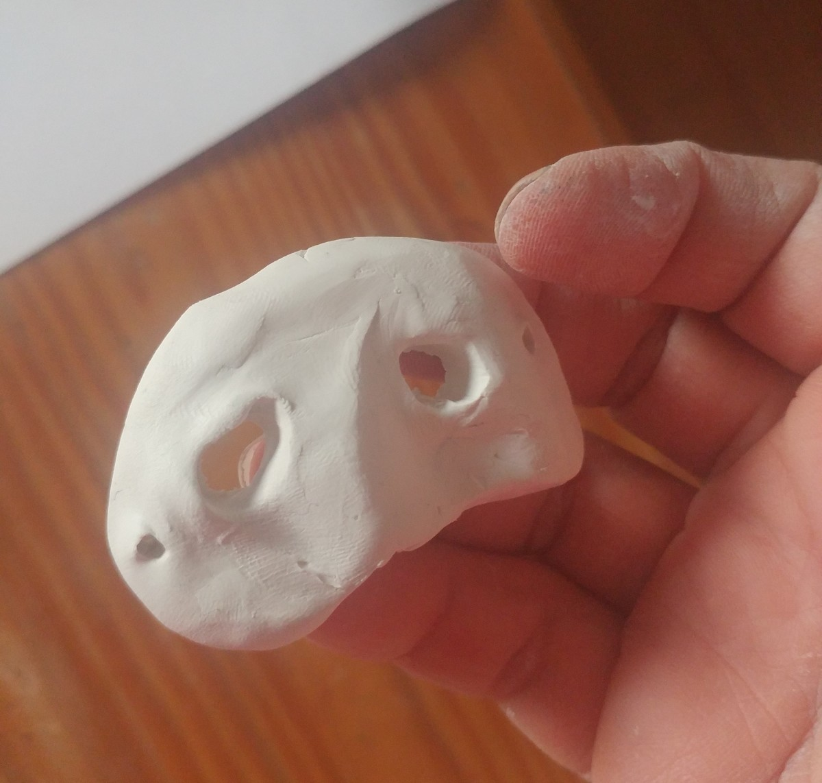 Shape a relatively small piece of polymer clay into the mask.
