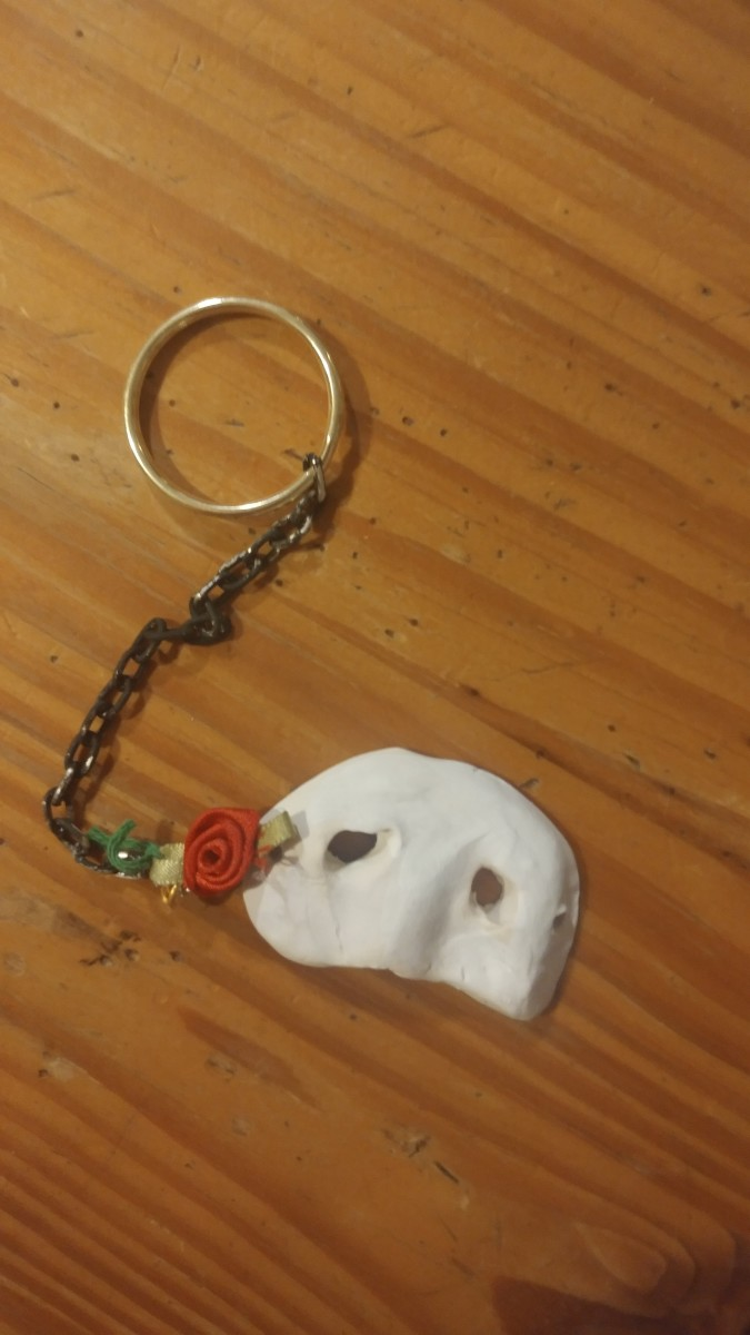 The mask keychain is a must have, for Phantom of the Opera fans.