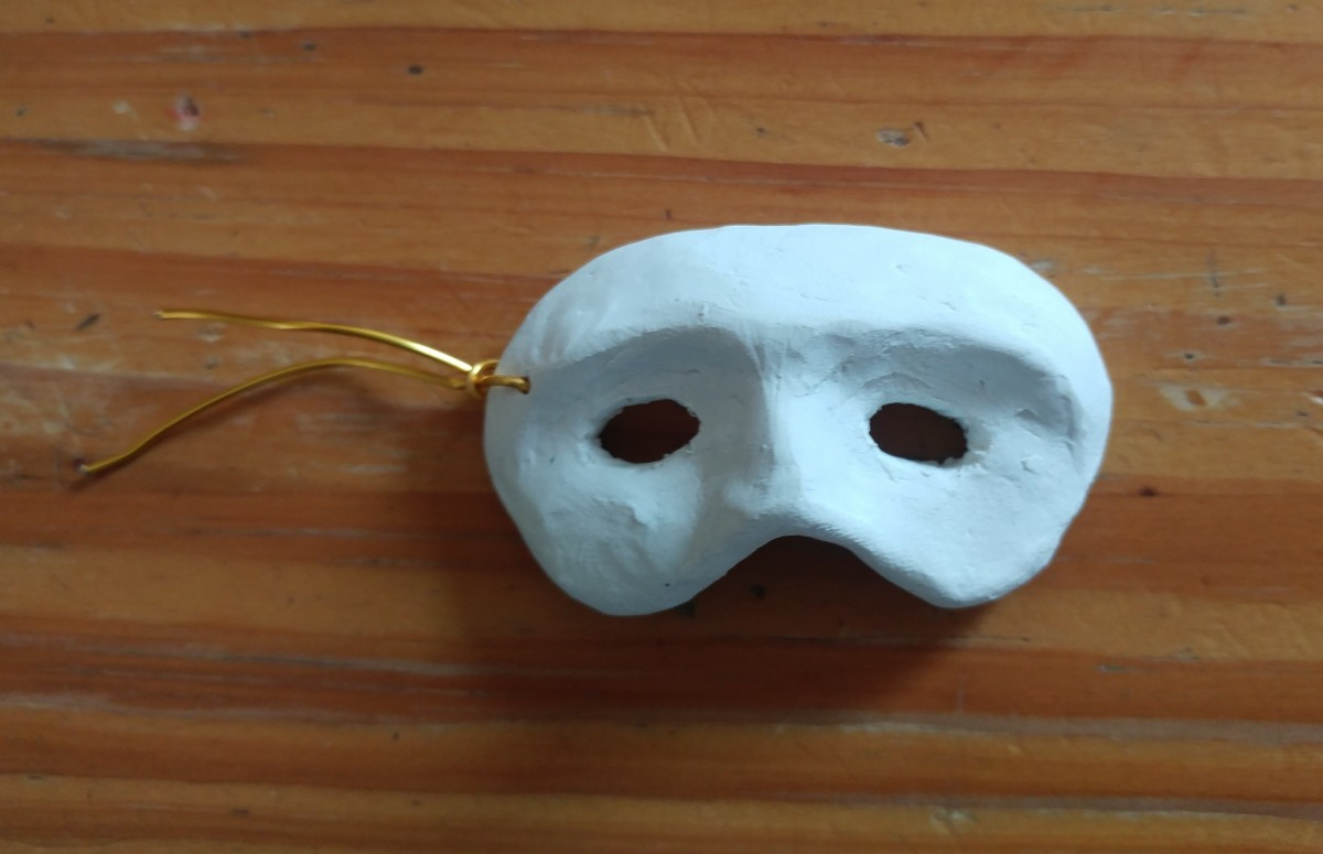 A professional artist shaped this particular mask, for a keychain.