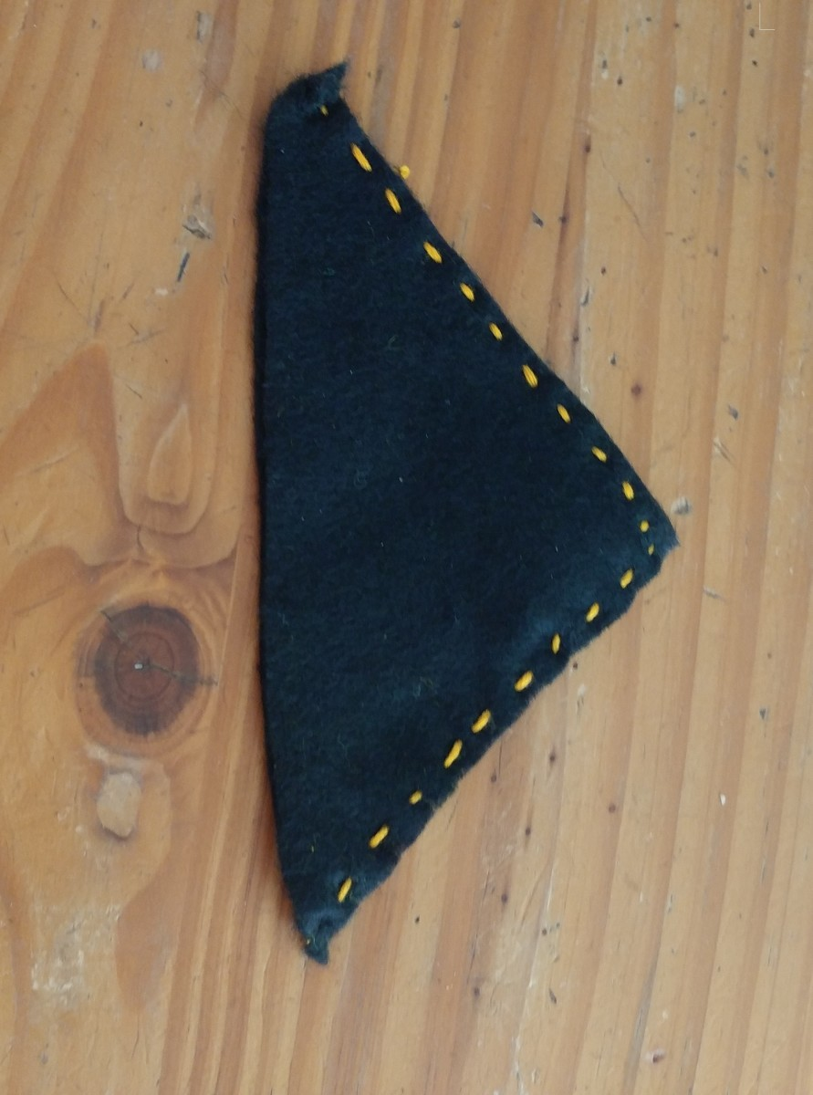Sew two sides together, leaving bottom of triangle open.