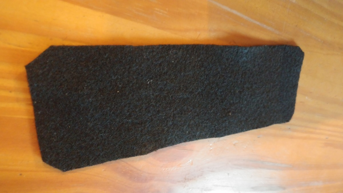 Cut a piece of black felt to the size of a bookmark.