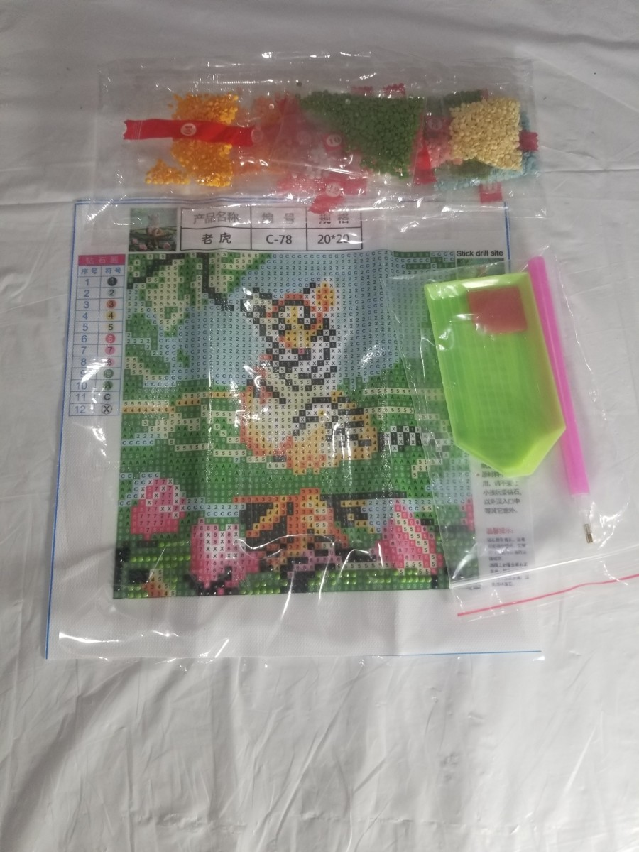 This is what's included in a small diamond painting kit.