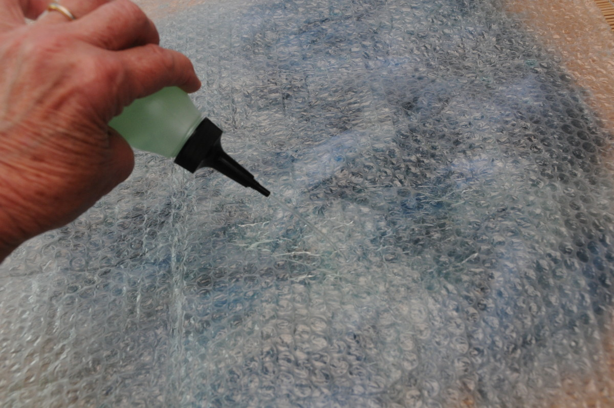 Wetting the surface of the bubble wrap using warm soapy water which will help facilitate easy rubbing of the fingers on the surface.