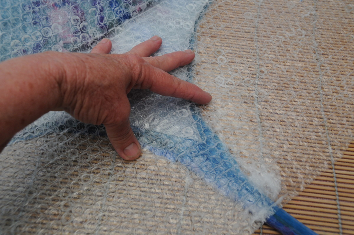 Rubbing on the bubble wrap