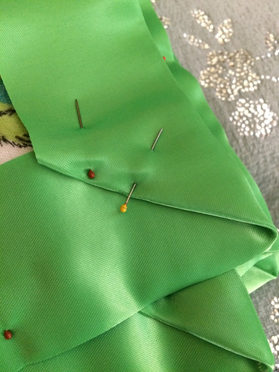 Use as many straight pins as necessary to secure your blanket binding. This will allow you to have straight machine stitching.