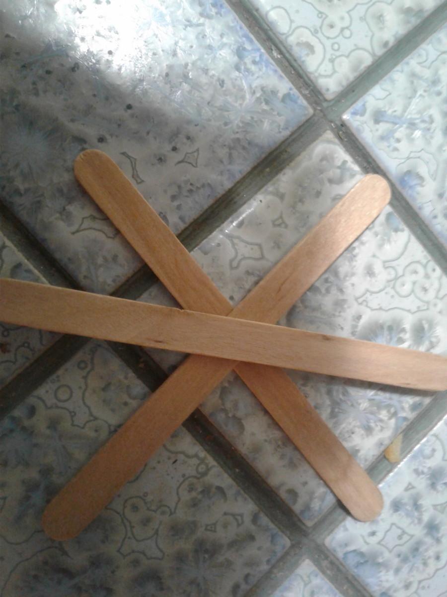 Arrange some sticks to create a base.