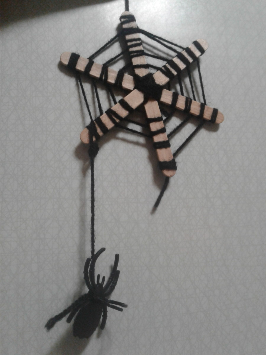 A finished example of a creepy spider web.
