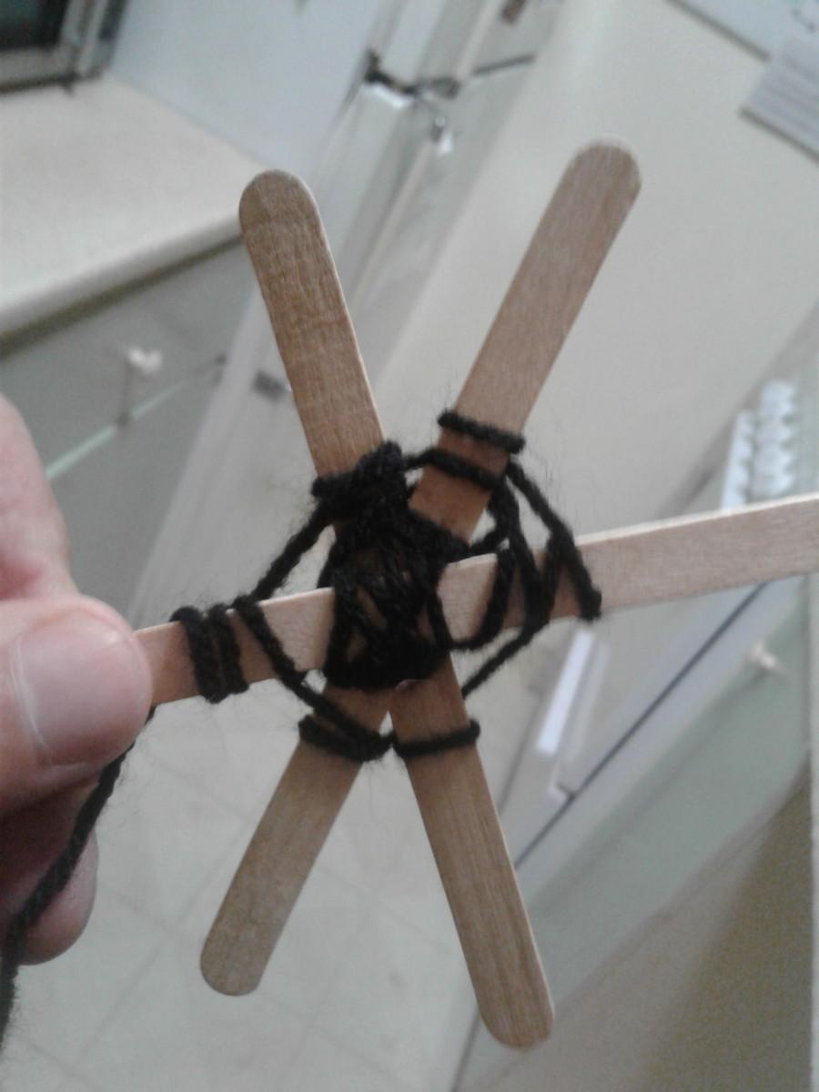 Add yarn or string.
