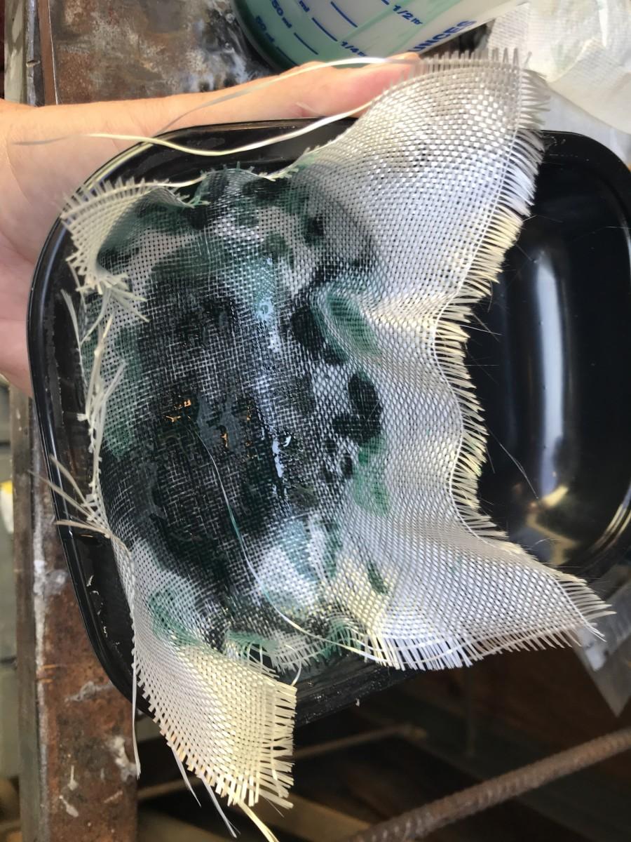 Applying Precut Fiberglass Cloth to Mold Cavity